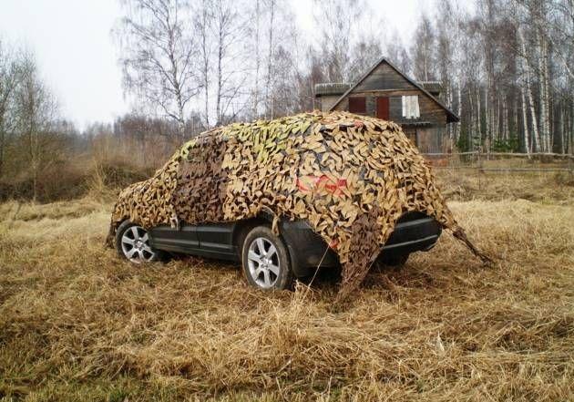 Защита автомобиля от солнечных лучей с помощью маскировочной сетки